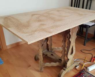 Dinning table from old furniture and chipboard.
